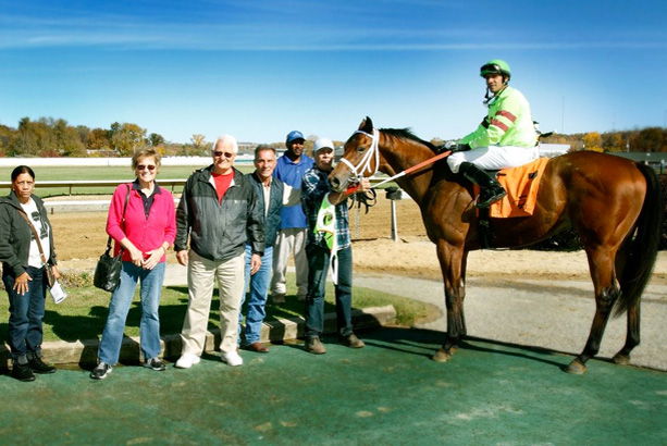Mapleton Thoroughbred Farm racing horse and jockey alongside owners and staff